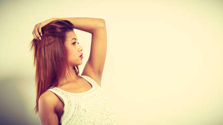 Beauty of feminine, beautiful women concept. Attractive woman with exotic skin look posing and brown hair.