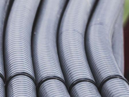 Machines, production concept. Detailed closeup of flexible plastic hose, pipes. Archivio Fotografico