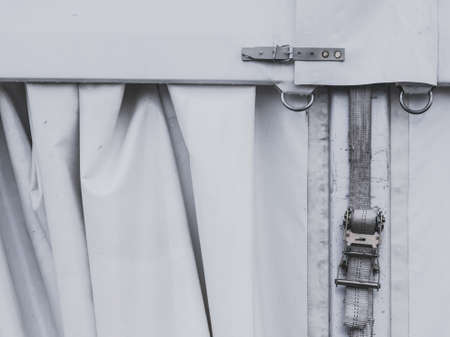 Close up of white party event tent details, hooks, stripes, cord strings. Detailed objects concept.