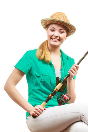 Fishery, spinning equipment, angling sport and activity concept. Woman with fishing rod. Banque d'images