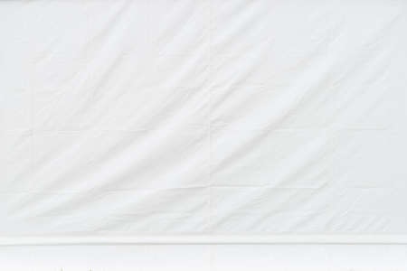 Close up of light background texture pattern white tarpaulin with creasings