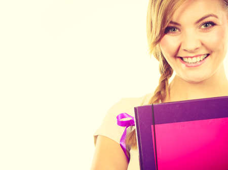 School, education concept. Young teenage student with braid holding books, going to study. Reklamní fotografie