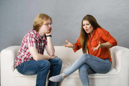 Woman accusing man. Couple having relationship problems, female being mean and rude, bored guy listening to her.