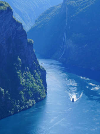 Fjord Geirangerfjord with ferry boat, view from Ornesvingen viewing point, Norway. Travel destination