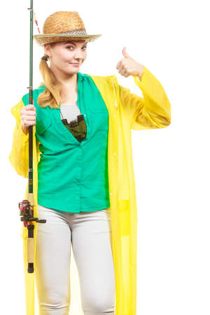 Fishery, spinning equipment, angling sport and activity concept. Woman with fishing rod showing thumb up gesture