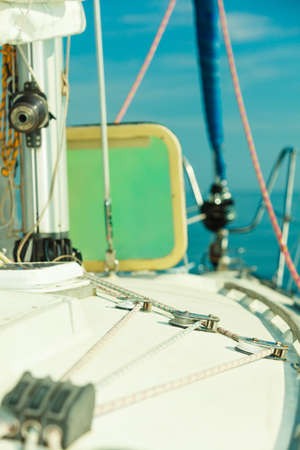 Detailed closeup of rigging on sail boat during cruise. Marine objects concept.