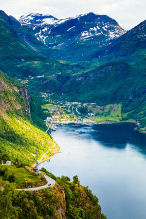 Tourism vacation and travel. Beautiful view over magical Geirangerfjorden from Flydalsjuvet viewpoint, Norway Scandinavia. Imagens - 115693345