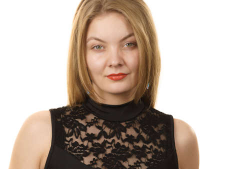 Blonde woman wearing black top with laced detail on cleavage. Fashion, clothing style concept. Standard-Bild