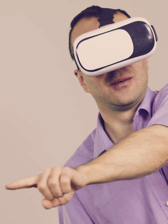 Business man wearing virtual reality goggles headset, vr box. Connection, technology, new generation and progress concept, on grey