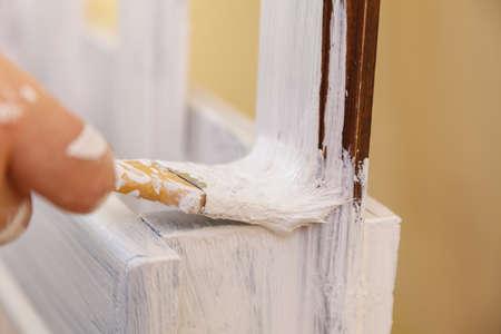 Home decor, color change, diy concept. Person renovating hanger made of wood. Reklamní fotografie
