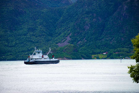HOGSFJORD, NORWAY - JUNE 22, 2018: The ferry transported cars from Lauvvik to Oanes on tourist route Ryfylke Rv13, on June 22, 2018, Norway