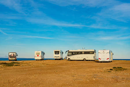 TORREVIEJA, SPAIN - JANUAR 30, 2019: Campers, motorhomes and recreational vehicles on mediterranean coast of Torrevieja seaside spanish city on the Costa Blanca, on Januar 30, 2019, Spain Editorial