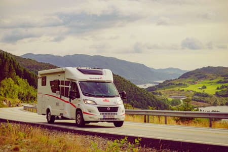 SANDE, NORWAY - JUNE 22, 2018: Sunlight camper van motor home drive on tourist route Ryfylke Rv13, on June 22, 2018, Norway
