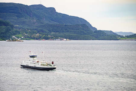 JOSENFJORD, NORWAY - JUNE 22, 2018: The ferry transported cars from Hjelmeland to Nesvik on tourist route Ryfylke Rv13, on June 22, 2018, Norway Редакционное