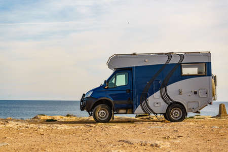 TORREVIEJA, SPAIN - JANUAR 30, 2019: Iveco off-road camper 4x4, rv motorhome on mediterranean coast of Torrevieja seaside spanish city on the Costa Blanca, on Januar 30, 2019, Spain