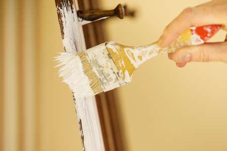 Home decor, color change, diy concept. Person renovating hanger made of wood. Standard-Bild - 117027263