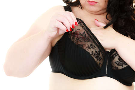 Plus size fat mature unrecognizable woman wearing black lace soft bra. Female breast in lingerie. Bosom, brafitting and underwear concept.