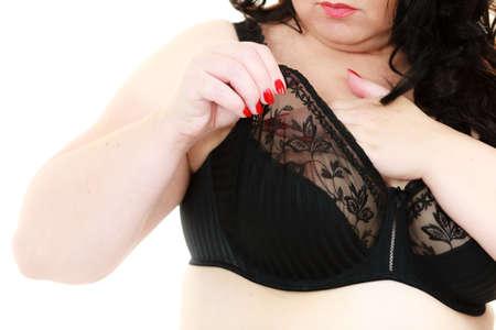 Plus size fat mature unrecognizable woman wearing black lace soft bra. Female breast in lingerie. Bosom, brafitting and underwear concept. 스톡 콘텐츠 - 117115636