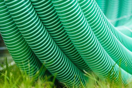 Machines, production concept. Detailed closeup of flexible plastic hose, pipes. Фото со стока
