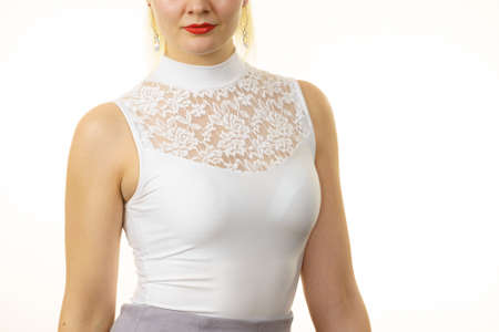 Unrecognizable woman wearing white top with laced detail on cleavage. Fashion, clothing style concept. 写真素材
