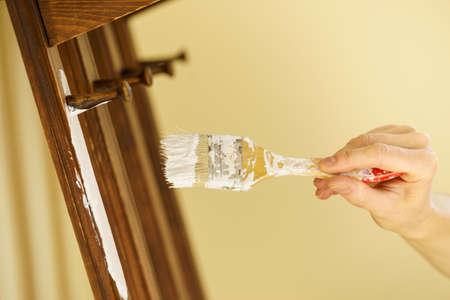 Home decor, color change, diy concept. Person renovating hanger made of wood. Banque d'images - 118465090