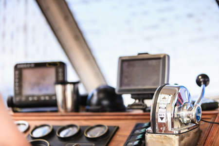 Sailing navigation panel console on sail boat. Navi sea equipment, screens and modern compass Standard-Bild