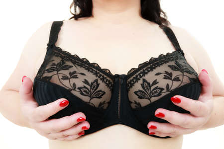 Close up female big in lingerie, wide angle view. Plus size fat woman wearing black lace soft bra. Bosom, brafitting and underwear concept.
