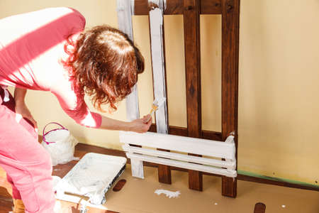 Home decor, color change, diy concept. Person renovating hanger made of wood. Standard-Bild - 120868163