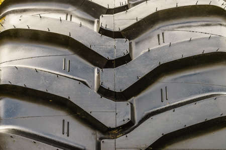 Tires treads changing, automotive concept. Detailed closeup of rubber tire wheel surface.