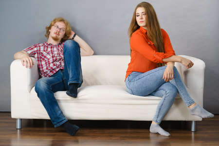 Man and woman being mad, ignoring each other after fight. Friendship, couple breakup difficulties and problems concept. Stock Photo