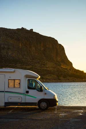 Camper car and Greek island Monemvasia, Greece, east coast of the Peloponnese, Lakonia. Travel destinations. 스톡 콘텐츠