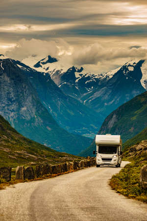 Mountains landscape and camper car on national tourist scenic route Gamle Strynefjellsvegen. Travel in motor home and adventure.