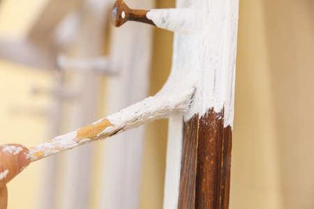 Home decor, color change, diy concept. Person renovating hanger made of wood. Standard-Bild - 122423657