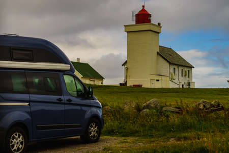Travel holidays in motorhome. Camper van at Obrestad lighthouse in south Norway, Norwegian national tourist county route road 44 Jaeren.