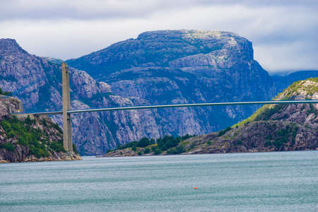 Fjord landscape. suspension bridge over Lysefjord. National tourist route Ryfylke. Vacation and travel.