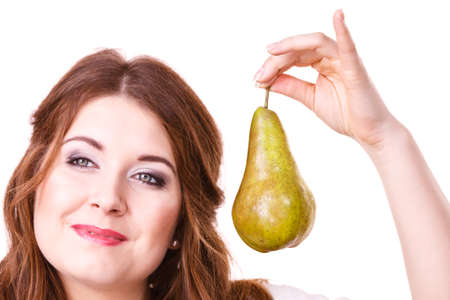 Woman dark hair holding green pear fruit, recommend detox fruit diet, isolated on white. Healthy dieting, vegan food, vitamins immunity concept.