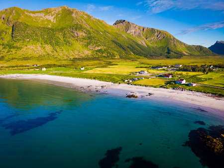 Coast of Gimsoya island, Gimsoysand sandy beach in summer. Nordland county, Lofoten archipelago Norway. Tourist attraction.