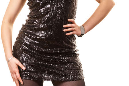 Close up of woman black skirt with sequins glowing. Party outfit details concept.