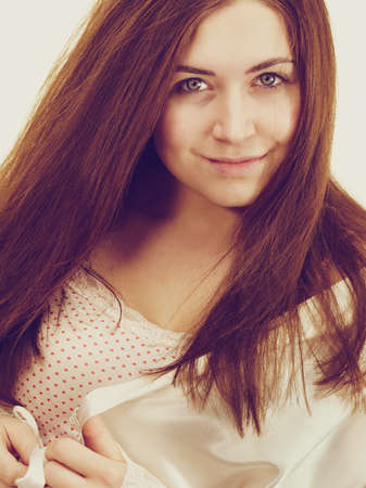 Young woman long brown hair without makeup. Natural beauty. Purity skincare spa treatment. 写真素材