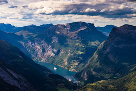 Tourism vacation and travel. Fantastic view on Geirangerfjord and mountains landscape from Dalsnibba viewpoint in Norway. 写真素材