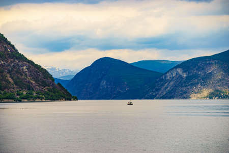 Fjord landscape with ship in Norway, Scandinavia Europe. Tourism vacation and travel