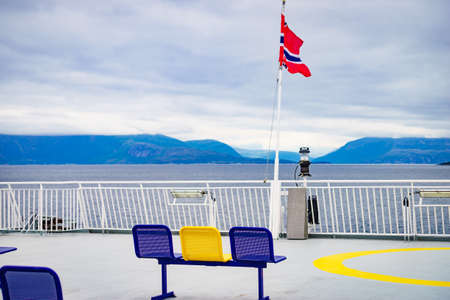 Ferry deck with empty seats and sea view. Ferryboat ride route Bognes - Lodingen to Lofoten islands Norway. Tourism vacation and travel. 写真素材