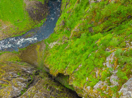 Top down view. River in green summer mountains, Mabodalen valley Norway. National tourist Hardangervidda route. Imagens