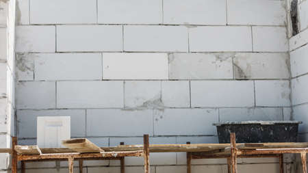 Details of house home construction site. Provisional walls made of grey blocks. Stok Fotoğraf