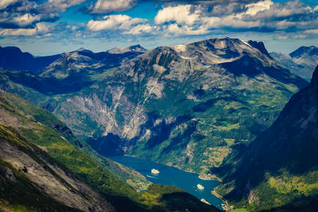 Tourism vacation and travel. Fantastic view on Geirangerfjord and mountains landscape from Dalsnibba viewpoint in Norway. Imagens