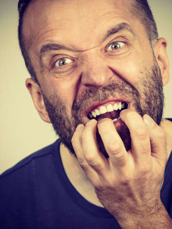 Stress, anxiety, emotions and problems concept. Scared, stressed man biting his nails