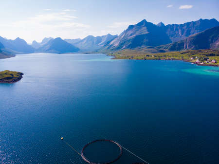 Sea with mountains, norwegian summer landscape on Lofoten archipelago Nordland county, Norway. Tourist attraction. 写真素材