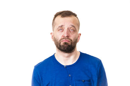 Very sad and worried adult man. Guy being depressed looking down. Studio shot.