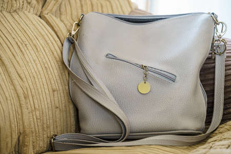 Gray big purse bag with zipper on front. Fashion, clothing details concept. Stock fotó