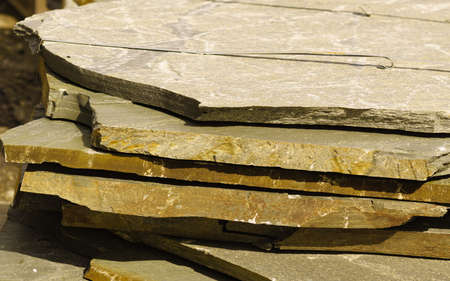 Stone masonry material on construction site. Industrial cobblestones for paving terrace, road or sidewalk. Building materials.